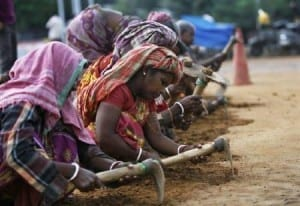 Women in India: Woman labourers work at a road construction site