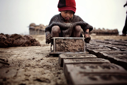 For year-old Yadhu making bricks with moulds. Picture By: RFI