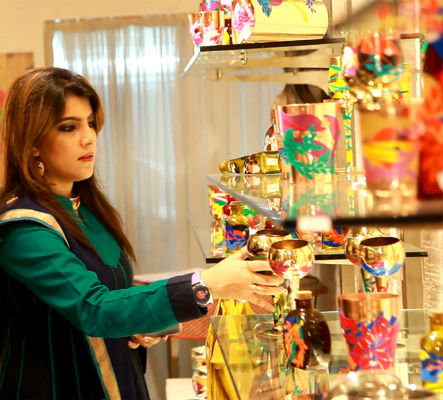 Sahar Zaman arranging products by her design brand Chamak Patti for a recent show in Delhi