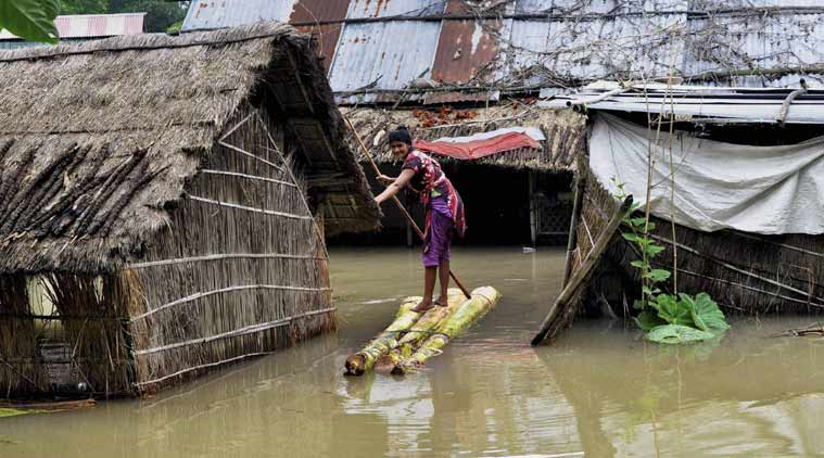 Woman in floods, Assam flood
