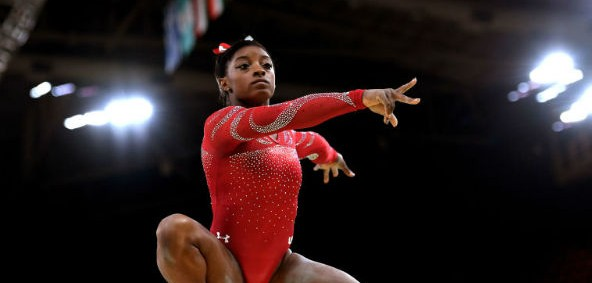 Simone Biles performing her best land