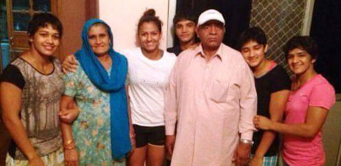 Mahavir Singh Phogat and his daughters