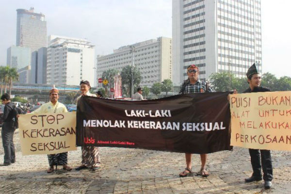 Indonesian men wear miniskirts to end violence against women