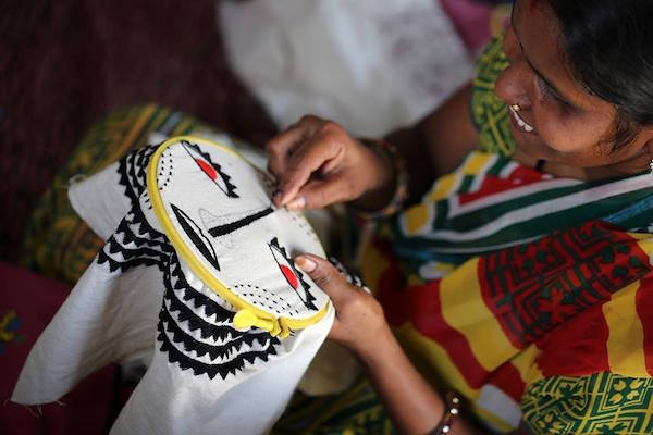 Women embroiders at skills camp