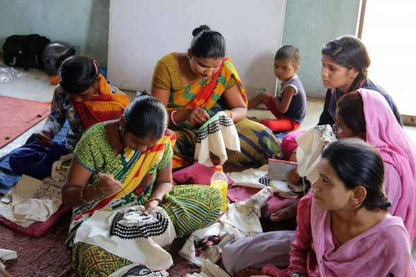 Women stitching in Aham Bhumika's embroidery class