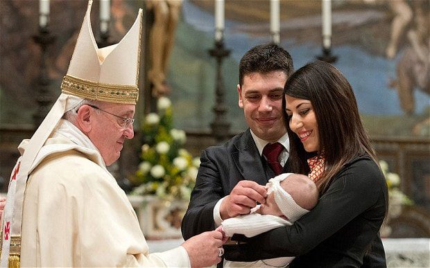 Pope Francis baptises a baby at the Sistine Chapel on January 8, 2017