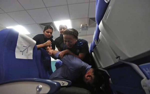 Indigo air-hostesses tie down unruly passenger