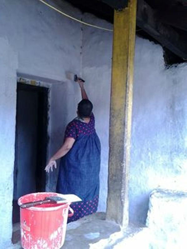 Women take charge of painting the house