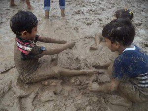 Children playing with wet sand.