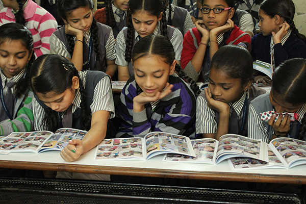 Kids reading Menstrupedia