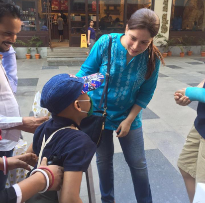 Nikita interacting with a child who has cancer