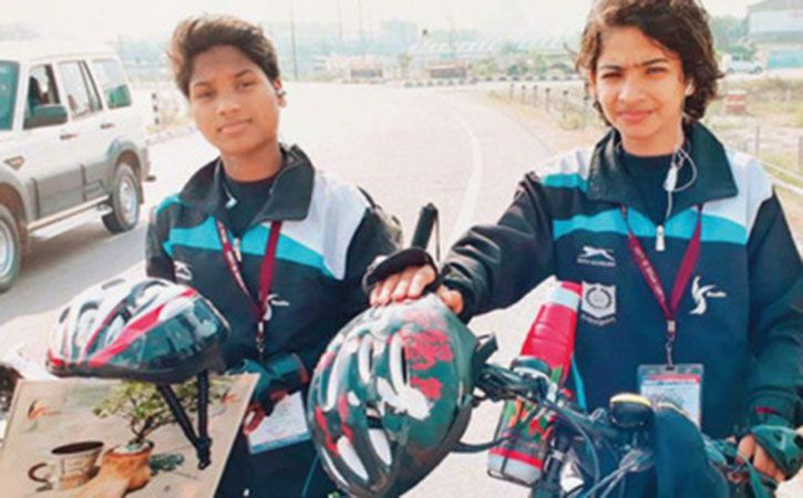 two girls use pedal power to empower women