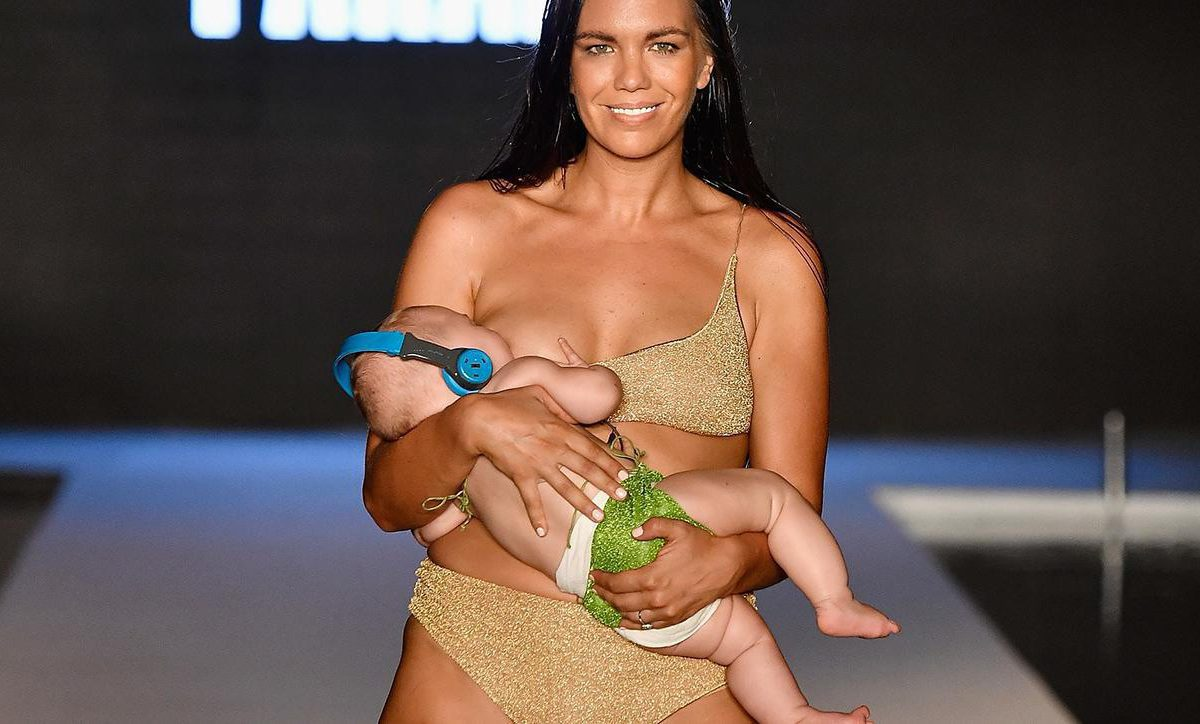 model breastfeeds baby runway