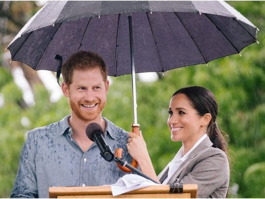 Meghan holding umbrella