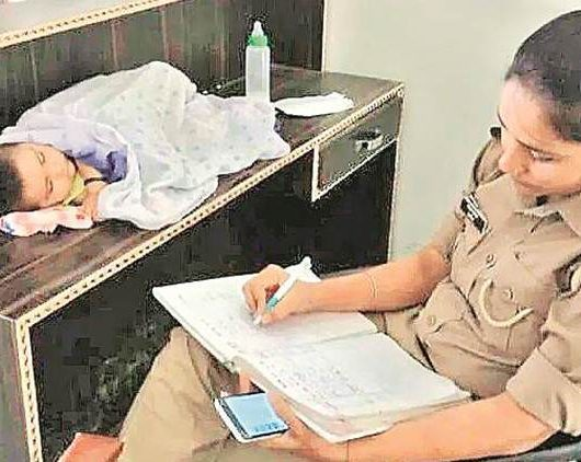 woman cop transferred home base