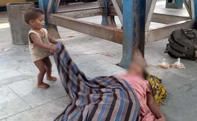 Baby Plays Mother's Shroud, toddler plays dead mother