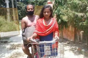 Bicycle Girl Carries Injured Father