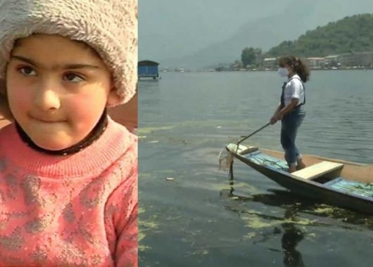 7 year old girl cleaning dal lake