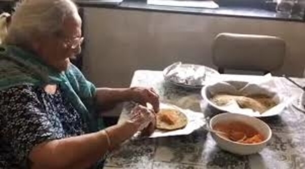 99-year-old prepares food packets