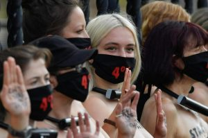 Bare-Chested Women Lock UK Parliament