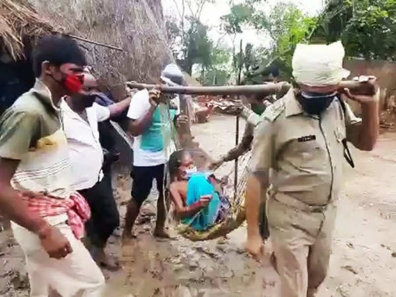 Cyclonic Storm Yaas updates, Odisha police carry elderly woman to cyclone shelter